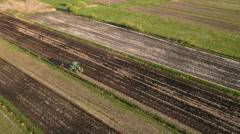 Aerial: Farmer Cultivating a Field - stock footage
