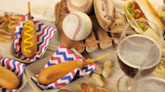 Baseball party food with balls and glove on a wood table. Stock Footage