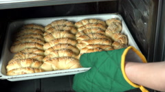 Baking croissant cookies, taking the tray out of the oven Stock Footage