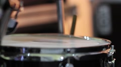 Rhythmic drum beats produced by a drummer during a performance - stock footage