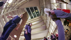 4K Low angle view looking up, diverse business group walking in modern office Stock Footage