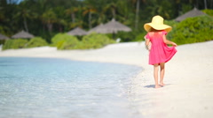 Adorable little girl at beach during summer vacation Stock Footage