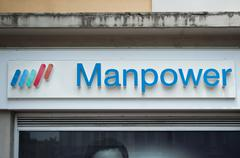 """Manpowers"" french temporary employment agency signage Stock Photos"