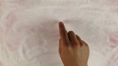 Men hand draws word heart sign on the surface of sugar - stock footage