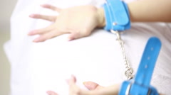 female hands in leather handcuffs. sex toys - stock footage