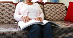Senior woman reading book in braille Stock Footage