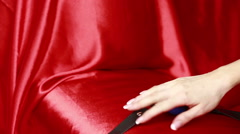 Fetish bdsm gag in female hand. sex toys. red sheets Stock Footage