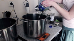 Girl Pours Oil Into Pot From Plastic Bottle In The Kitchen Stock Footage