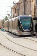 JERUSALEM, ISRAEL - FEBRUARY 15, 2013: People using modern rapid tram i - stock photo