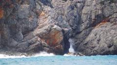 High wave breaking on rocky coast on Mallorca - stock footage