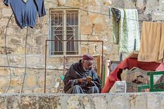 JERUSALEM, ISRAEL - FEBRUARY 15, 2013: Priest of Ethiopian Orthodox Tewahedo  - stock photo