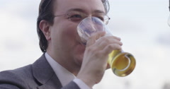 Asian business man drinks beer and laughs 4K - stock footage