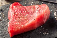Raw Organic Pink Tuna Steak - stock photo