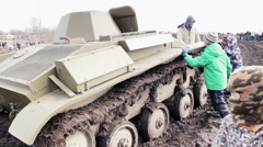 Children Playing With Real Tank And Try To Climbed On - stock footage