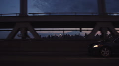 Slow motion sunset drive over the Triboro/RFK bridge in Queens, NY Stock Footage