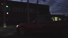A drive through Queens, New York City at sunset as a car pulls away Stock Footage