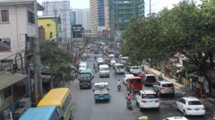 Philippine traffic from overhead pass Stock Footage