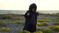 The child plays on the coast of cold ecologically dirty sea Stock Footage