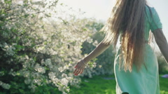 Girl with long red hair in apple garden Stock Footage