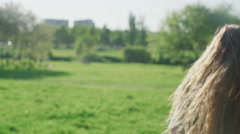 Girl with long red hair have fun in the park Stock Footage