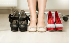 Conceptual photo of woman choosing most comfortable shoes Stock Photos