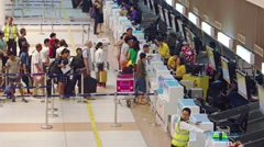 Travelers lined up at the ticketing counter at Phuket Airport in Thailand Stock Footage