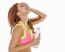 Attractive Asian woman with water bottle after exercise - stock photo