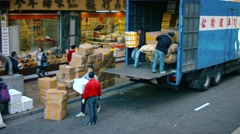Laborers unloading cargo from a truck on an commercial street in Hong Kong Stock Footage