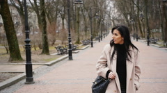 Sexy fashionable woman walking in the autumn park Stock Footage