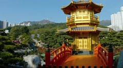 Golden pagoda with ornate bridge and gardens at Chi Lin Nunnery in Hong Kong Stock Footage