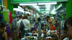 Shoppers browsing in a discount store in Singapore's Chinatown district Stock Footage