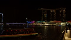 Spectacular night time view of Marina Bay Stock Footage