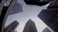 Rotating perspective of highrise buildings reaching skyward, in Hong Kong Stock Footage