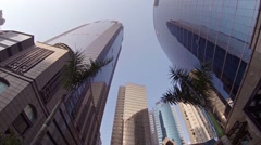 Upward tilting clip of modern buildings stretching skyward in Hong Kong Stock Footage
