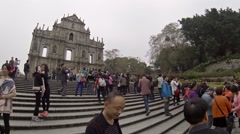 Tourists posing for pictures on front steps of ruins. Saint Paul Church. Maca Stock Footage