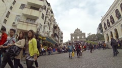 Crowds of tourists coming from the ruins of Saint Paul Church in Macau - stock footage