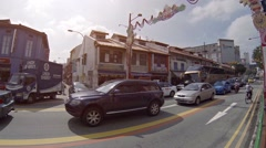 Typical traffic along a street in Singapore. Video 1080p Stock Footage