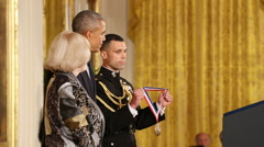 President Obama  Awards Dr. Mary-Claire King slow motion - stock footage