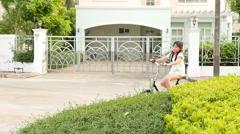 Beautiful asian girl riding a bike outside Stock Footage