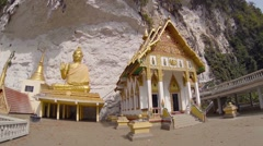 Wat Tham Kisap temple built at food of a cliff in Langkawi, Malaysia Stock Footage