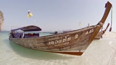 Longtail boat at Ao Nang, Thailand, as the camera dives beneath surface Stock Footage