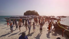 Crowd of tourists arriving by boat at Tup Island in Thailand, with sound Stock Footage