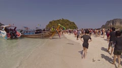 Many tourists enjoying sandy tropical beach paradise of Tup island. Thailand Stock Footage