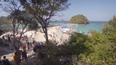 Tiny, Tup Island, overcrowded with tourists and boat traffic in Thailand - stock footage