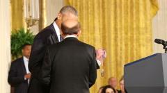 Obama  Awards Dr. Rakesh K. Jain - stock footage