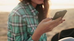 Young stylish pretty woman, hands holding a phone, denim shirt and jeans Stock Footage