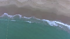 Waves rolling on the beach in Emerald Bay Stock Footage