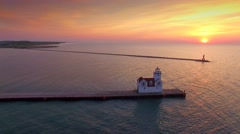Breathtakingly beautiful sunrise with lighthouse, aerial view Stock Footage