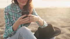 young stylish pretty woman, hands holding a phone, denim shirt and jeans - stock footage