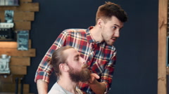 Barber asking man's wish about beard cut - stock footage